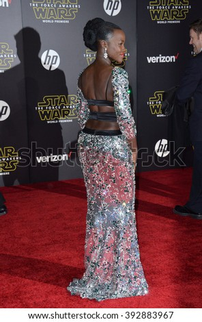 """LOS ANGELES, CA - DECEMBER 14, 2015: Actress Lupita Nyong'o at the world premiere of """"Star Wars: The Force Awakens"""" on Hollywood Boulevard - stock photo"""