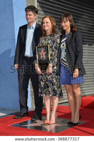 LOS ANGELES, CA - DECEMBER 3, 2015: Actresses Amy Poehler & Rashida Jones & writer Mark Schur on Hollywood Boulevard where Poehler was honored with the 2,566th star on the Hollywood Walk of Fame.  - stock photo