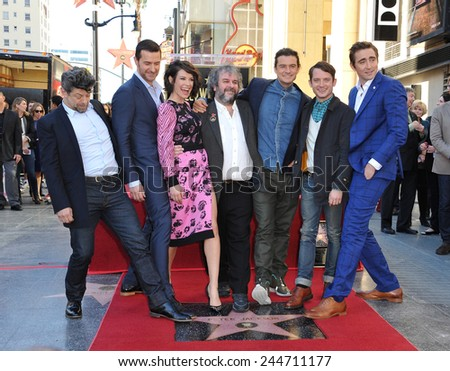 LOS ANGELES, CA - DECEMBER 8, 2014: Director Peter Jackson with actors Andy Serkis, Richard Armitage, Evangeline Lilly, Orlando Bloom, Elijah Wood & Lee Pace honored with a star on the Walk of Fame.  - stock photo