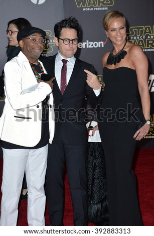 """LOS ANGELES, CA - DECEMBER 14, 2015: Directors J.J. Abrams & Spike Lee & wife Tonya Lewis Lee at the world premiere of """"Star Wars: The Force Awakens"""" on Hollywood Boulevard - stock photo"""