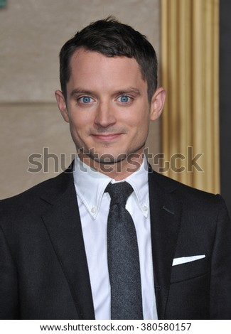 "LOS ANGELES, CA - DECEMBER 9, 2014: Elijah Wood at the Los Angeles premiere of his movie ""The Hobbit: The Battle of the Five Armies"" at the Dolby Theatre, Hollywood. - stock photo"