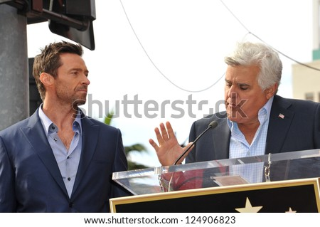 LOS ANGELES, CA - DECEMBER 13, 2012: Hugh Jackman & Jay Leno (right) on Hollywood Blvd where Jackman was honored with the 2,487th star on the Hollywood Walk of Fame. - stock photo