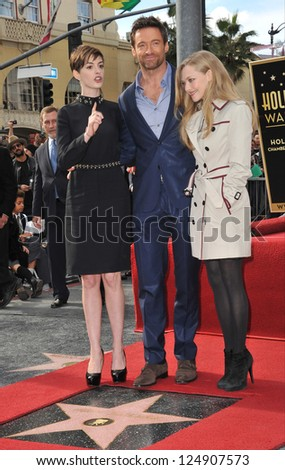 LOS ANGELES, CA - DECEMBER 13, 2012: Hugh Jackman with his Les Miserable co-stars Anne Hathaway (left) & Amanda Seyfried. Jackman was honored with the 2,487th star on the Hollywood Walk of Fame. - stock photo