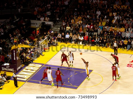 LOS ANGELES, CA - DECEMBER 25: Kobe Bryant shoots free throw during Christmas Day NBA Game L.A. Lakers versus the Miami Heat at Staples Center. on December 25, 2010 in Los Angeles - stock photo