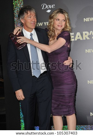"""LOS ANGELES, CA - DECEMBER 5, 2011: Michelle Pfeiffer & husband David E. Kelley at the world premiere of her new movie """"New Year's Eve"""" at Grauman's Chinese Theatre. December 5, 2011  Los Angeles, CA - stock photo"""