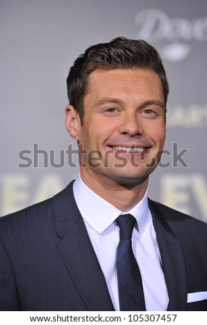"""LOS ANGELES, CA - DECEMBER 5, 2011: Ryan Seacrest at the world premiere of his new movie """"New Year's Eve"""" at Grauman's Chinese Theatre, Hollywood. December 5, 2011  Los Angeles, CA - stock photo"""