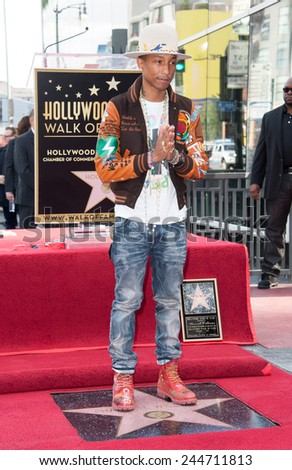 LOS ANGELES, CA - DECEMBER 4, 2014: Singer/songwriter Pharrell Williams on Hollywood Boulevard where he was honored with the 2,537th star on the Hollywood Walk of Fame.  - stock photo