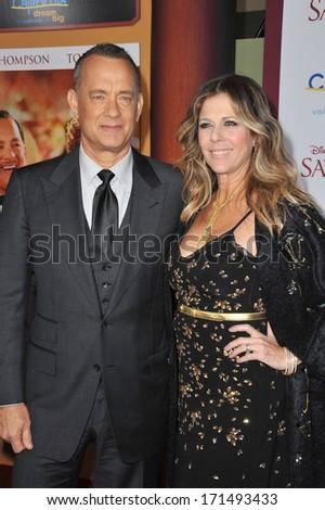 "LOS ANGELES, CA - DECEMBER 9, 2013: Tom Hanks & wife Rita Wilson at the US premiere of his movie ""Saving Mr Banks"" at Walt Disney Studios, Burbank.  - stock photo"