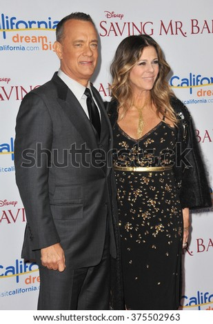 "LOS ANGELES, CA - DECEMBER 9, 2013: Tom Hanks & wife Rita Wilson at the US premiere of his movie ""Saving Mr Banks"" at Walt Disney Studios, Burbank.  - stock photo"