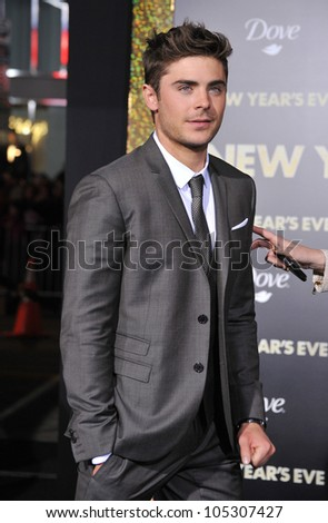 "LOS ANGELES, CA - DECEMBER 5, 2011: Zac Efron at the world premiere of his new movie ""New Year's Eve"" at Grauman's Chinese Theatre, Hollywood. December 5, 2011  Los Angeles, CA - stock photo"
