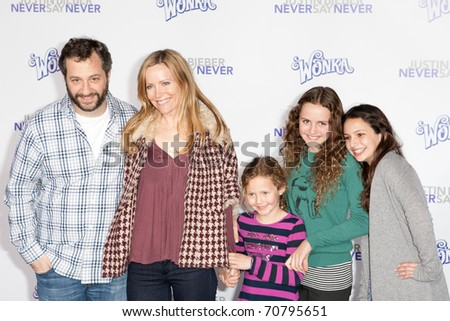 LOS ANGELES, CA - FEB 8: Director Judd Apatow & actress Leslie Mann with guests arrive at the Justin Bieber: Never Say Never premiere at Nokia Theater L.A. Live on February 8, 2011 in Los Angeles. - stock photo