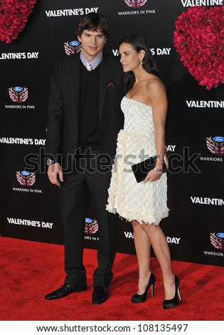 "LOS ANGELES, CA - FEBRUARY 8, 2010: Ashton Kutcher & Demi Moore at the world premiere of his new movie ""Valentine's Day"" at Grauman's Chinese Theatre, Hollywood. - stock photo"