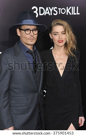 """LOS ANGELES, CA - FEBRUARY 12, 2014: Johnny Depp & fiance Amber Heard at the US premiere of her movie """"3 Days To Kill"""" at the Arclight Theatre, Hollywood.  - stock photo"""