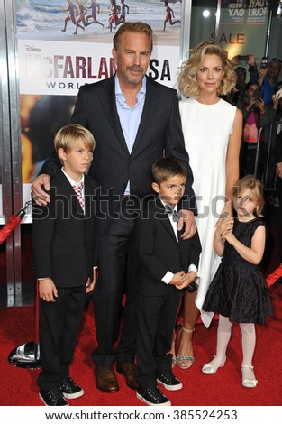 "LOS ANGELES, CA - FEBRUARY 9, 2015: Kevin Costner & wife Christine Baumgartner & children at the world premiere of his movie ""McFarland USA"" at the El Capitan Theatre, Hollywood. - stock photo"