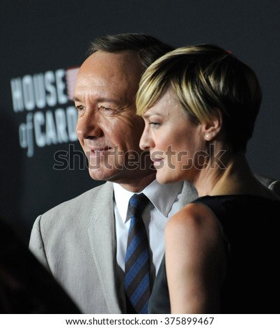 """LOS ANGELES, CA - FEBRUARY 13, 2014: Robin Wright & Kevin Spacey at the season two premiere of their Netflix series """"House of Cards"""" at the Directors Guild Theatre. - stock photo"""