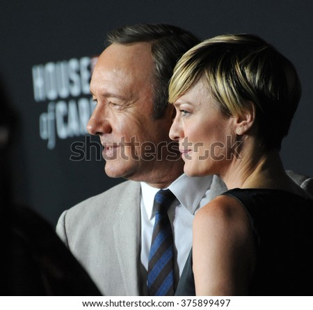 "LOS ANGELES, CA - FEBRUARY 13, 2014: Robin Wright & Kevin Spacey at the season two premiere of their Netflix series ""House of Cards"" at the Directors Guild Theatre.