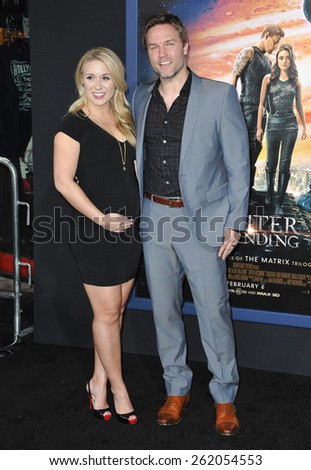 "LOS ANGELES, CA - FEBRUARY 2, 2015: Scott Porter & wife Kelsey Mayfield at the Los Angeles premiere of ""Jupiter Ascending"" at the TCL Chinese Theatre, Hollywood.