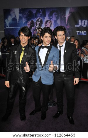 "LOS ANGELES, CA - FEBRUARY 24, 2009: The Jonas Brothers - Kevin Jonas (left), Joe Jonas & Nick Jonas - at the world premiere of ""Jonas Brothers: The 3D Concert Experience"" at the El Capitan Theatre. - stock photo"