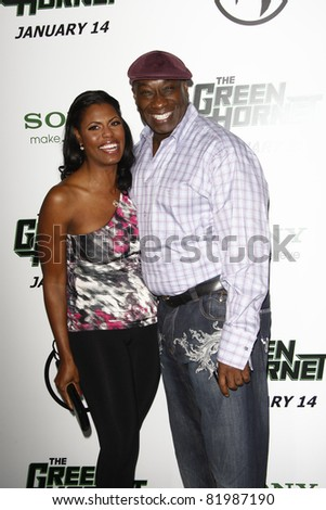 LOS ANGELES, CA - JAN 10: Omarosa and Michael Clarke Duncan at the premiere of 'The Green Hornet' at Grauman's Chinese Theater in Los Angeles, California on January 10, 2011 - stock photo
