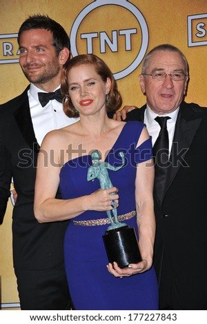 LOS ANGELES, CA - JANUARY 18, 2014: Amy Adams, Robert De Niro & Bradley Cooper at the 20th Annual Screen Actors Guild Awards at the Shrine Auditorium.  - stock photo