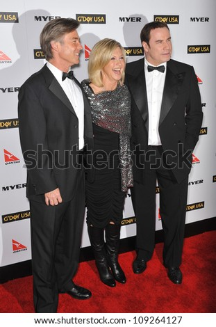 LOS ANGELES, CA - JANUARY 16, 2010: John Travolta & Olivia Newton-John & date (left) at the 2010 G'Day USA Australia Week Black Tie Gala at the Grand Ballroom at Hollywood & Highland. - stock photo
