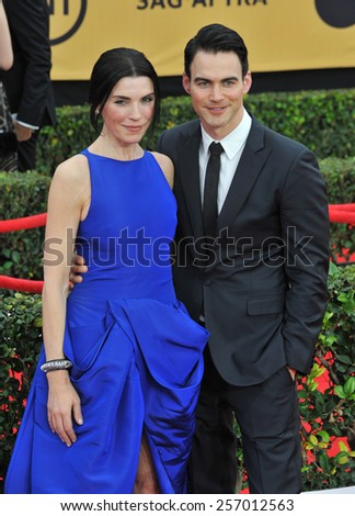 LOS ANGELES, CA - JANUARY 25, 2015: Julianna Margulies & husband Keith Lieberthal at the 2015 Screen Actors Guild  Awards at the Shrine Auditorium.  - stock photo