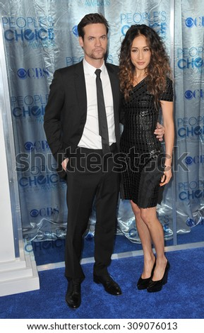 LOS ANGELES, CA - JANUARY 5, 2011: Maggie Q & Shane West at the 2011 Peoples' Choice Awards at the Nokia Theatre L.A. Live in downtown Los Angeles.  - stock photo