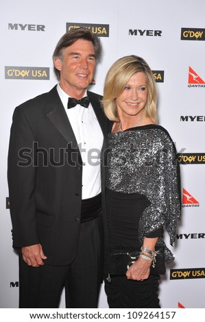 LOS ANGELES, CA - JANUARY 16, 2010: Olivia Newton-John & date at the 2010 G'Day USA Australia Week Black Tie Gala at the Grand Ballroom at Hollywood & Highland. - stock photo