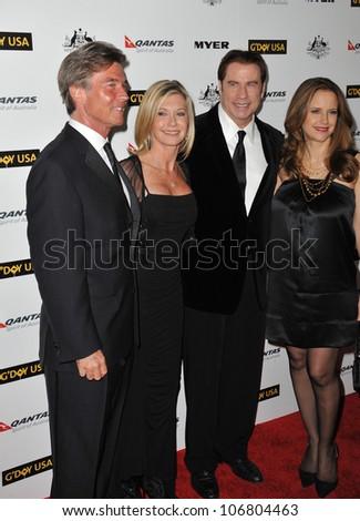 LOS ANGELES, CA - JANUARY 22, 2011: Olivia Newton-John & husband John Easterling (left) with John Travolta & Kelly Preston at the 2011 G'Day USA Black Tie Gala at the Hollywood Palladium. - stock photo