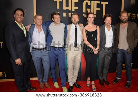 "LOS ANGELES, CA - JULY 30, 2015: Adam Lazarre-White (left), Tim Griffin, producer Jason Blum, Joel Edgerton, Rebecca Hall, Jason Bateman & David Denman at the premiere of ""The Gift"" - stock photo"