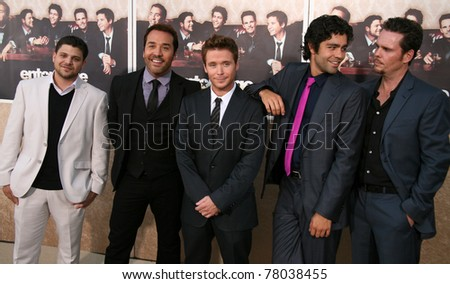 LOS ANGELES, CA - JULY 9: Entourage cast members show some brotherly love as the sixth Season Premiere kicks off on set of Paramount Pictures lot in Los Angeles, CA on July 9, 2009. - stock photo