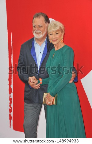"""LOS ANGELES, CA - JULY 11, 2013: Helen Mirren & husband Taylor Hackford at the Los Angeles premiere of her new movie """"Red 2"""" at the Westwood Village Theatre.  - stock photo"""