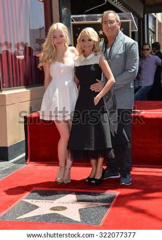 LOS ANGELES, CA - JULY 24, 2015: Kristin Chenoweth with Kenny Ortega & Dove Cameron on Hollywood Blvd where Chenoweth was honored with the 2,555th star on the Hollywood Walk of Fame. - stock photo