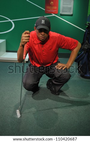 LOS ANGELES, CA - JULY 21, 2009: Tiger Woods waxwork figure - grand opening of Madame Tussauds Hollywood. - stock photo