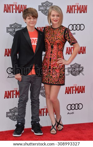 "LOS ANGELES, CA - JUNE 29, 2015: Actor Ty Simpkins & sister actress Ryan Simpkins at the world premiere of ""Ant-Man"" at the Dolby Theatre, Hollywood.  - stock photo"