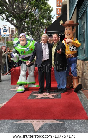 LOS ANGELES, CA - JUNE 2, 2010: Composer Randy Newman (left) & Disney-Pixar boss  John Lasseter with Toy Story stars Buzz Lightyear & Woody was honored today with a star on the Hollywood Walk of Fame. - stock photo