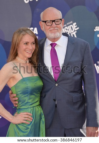"""LOS ANGELES, CA - JUNE 9, 2015: Frank Oz & wife Victoria Labalme at the Los Angeles premiere of his movie Disney-Pixar's """"Inside Out"""" at the El Capitan Theatre, Hollywood. - stock photo"""