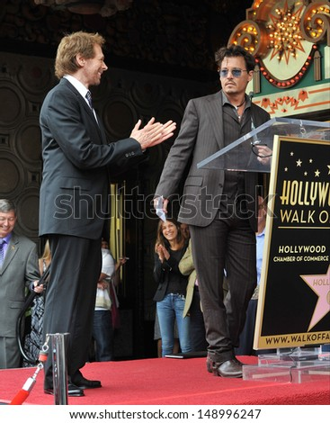 LOS ANGELES, CA - JUNE 24, 2013: Jerry Bruckheimer & Johnny Depp on Hollywood Boulevard where Jerry Bruckheimer was honored with the 2,501st star on the Hollywood Walk of Fame.  - stock photo
