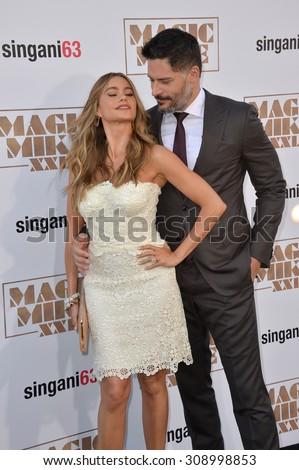 "LOS ANGELES, CA - JUNE 25, 2015: Joe Manganiello & fianc���©e Sofia Vergara at the world premiere of his movie ""Magic Mike XXL"" at the TCL Chinese Theatre, Hollywood.  - stock photo"