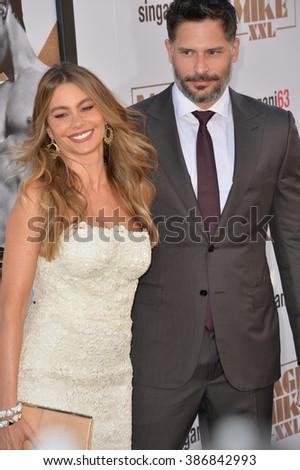 "LOS ANGELES, CA - JUNE 25, 2015: Joe Manganiello & fianc�©e Sofia Vergara at the world premiere of his movie ""Magic Mike XXL"" at the TCL Chinese Theatre, Hollywood. - stock photo"