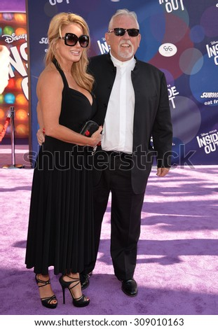 """LOS ANGELES, CA - JUNE 9, 2015: John Ratzenberger & wife Julie at the Los Angeles premiere of his movie Disney-Pixar's """"Inside Out"""" at the El Capitan Theatre, Hollywood.  - stock photo"""