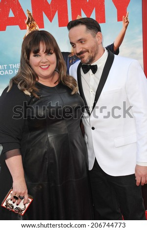 "LOS ANGELES, CA - JUNE 30, 2014: Melissa McCarthy & husband actor/writer/director Ben Falcone at the premiere of their movie ""Tammy"" at the TCL Chinese Theatre, Hollywood.  - stock photo"
