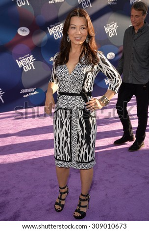 """LOS ANGELES, CA - JUNE 9, 2015: Ming-Na Wen at the Los Angeles premiere of Disney-Pixar's """"Inside Out"""" at the El Capitan Theatre, Hollywood.  - stock photo"""