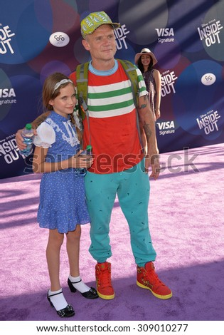 """LOS ANGELES, CA - JUNE 9, 2015: Red Hot Chili Peppers star Flea & daughter Sunny Bebop Balzary at the Los Angeles premiere of Disney-Pixar's """"Inside Out"""" at the El Capitan Theatre, Hollywood.  - stock photo"""