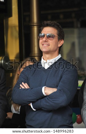 LOS ANGELES, CA - JUNE 24, 2013: Tom Cruise on Hollywood Boulevard where Jerry Bruckheimer was honored with the 2,501st star on the Hollywood Walk of Fame.  - stock photo