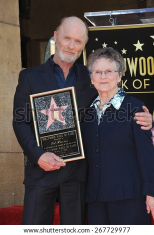 LOS ANGELES, CA - MARCH 13, 2015: Actor Ed Harris & mother Margaret Sholl Harris on Hollywood Boulevard where he was honored with the 2,546th star on the Hollywood Walk of Fame.  - stock photo