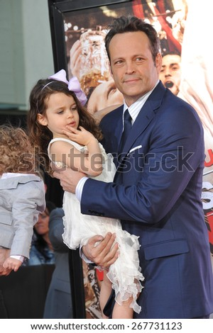 LOS ANGELES, CA - MARCH 4, 2015: Actor Vince Vaughn & daughter Lochlyn Kyla Vaughn at the TCL Chinese Theatre, Hollywood, where he had his hand and footprints set in cement.  - stock photo