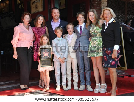 LOS ANGELES, CA - MARCH 5, 2015: Chris O'Donnell, wife Caroline Fentress & children Maeve, Finley, Charles, Christopher & Lily & his mother Julie Ann on Hollywood Blvd where he was honored with a star - stock photo