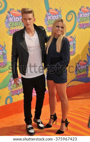 LOS ANGELES, CA - MARCH 29, 2014: Cody Simpson & Alli Simpson at Nickelodeon's 27th Annual Kids' Choice Awards at the Galen Centre, Los Angeles.  - stock photo