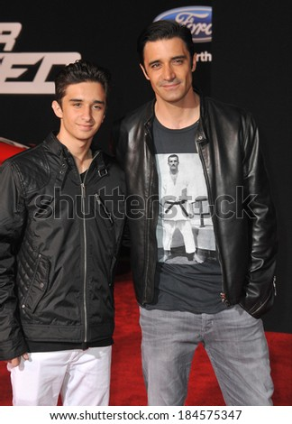 """LOS ANGELES, CA - MARCH 6, 2014: Gilles Marini & son George Marini at the U.S. premiere of """"Need for Speed"""" at the TCL Chinese Theatre, Hollywood.  - stock photo"""